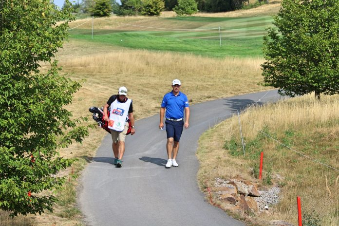 Padraig Harrington and his caddie during the 2018 D+D Real Czech Masters