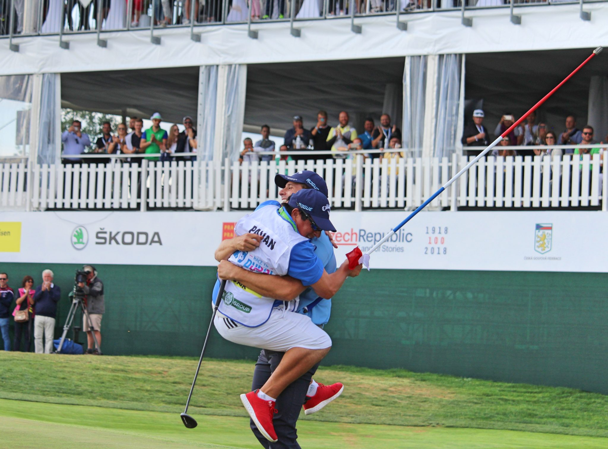 Andrea Pavan celebrates with his caddie
