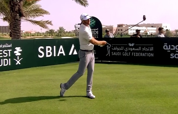 Dustin Johnson hits a tee shot during Saudi International