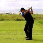Phil Mickelson hits a tee shot with an iron on a par 3