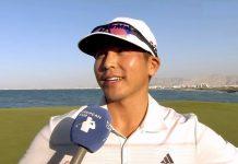 Kurt Kitayama talks to the media after his Oman Open triumph